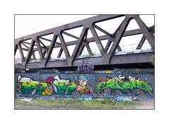 Street Art (Bronk, Upikone, 210Presents), East London, England. (Joseph O'Malley64) Tags: bronk upikone 210presents streetartists streetart urbanart publicart freeart graffiti eastlondon eastend london england uk britain british greatbritain art artists artistry artworks murals muralists wallmurals wall walls meetingofstyles meetingofstyles2017 railwayproprerty brickwork bricksmortar cement pointing securityspikes buddleia buddleiaflorets bridgespan railwaybridge reinforcedsteelbeams concrete steelrailings weeds grass openground brk trp therollingpeople urban urbanlandscape aerosol cans spray paint fujix x100t accuracyprecision