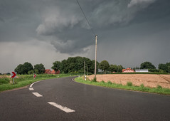 Doomsday (Martijn van Sabben) Tags: germany duitsland deutschland german road roads ngc clouds defotoblogger weather buienradar dark darkness olympus getolympus coolshot farm house houses homes europa europe bestoftherest green grey donker wolk wolken whatevertheweather
