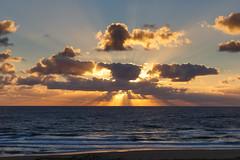 Face of the Sun (Harald Schnitzler) Tags: sunset clouds ocean sea sun face illusion rays sunrays water waves beach atlantic france coast