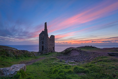 Sundown on the Empire (Pete Rowbottom, Wigan, UK) Tags: cargodnapumpingenginehouse whealowles bottallack cornwall stjust penwith pendeen mine tinmine coppermine cornish kernow peterowbottom sunset sundown dusk sun sunlight colourfulsunset colourful dramatic england red yellow purple art nikond750 wideangle longexposure longexposurelandscape landscape cornishcoast cornishcoastpath southwestcoastpath britishcoast coastline uk uklandscape ukcoast ukcoastline enginehouse texture detail watyer sky outdoor colourfulsky light clouds summer evening house orange lonehouse chimney slowshutterspeed slowshutter streaks stonebuilding heritage unesco worldheritagesite glow beautful peaceful tranquil geotagged photography horizon ocean sea