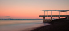 The Ghost on the Pier (Mike_Mulcahy) Tags: fuji fujifilm xt1 1855mm nz napier hawkesbay newzealand whoneedsfullframe pastel light colour color sea ocean pacific pier jetty hills mountains ghost ghostly girl