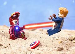 Iron-Man vs Captain America (jezbags) Tags: lego legos toys toy minifigure minifigures macro macrophotography macrodreams macrolego canon60d canon 60d 100mm closeup upclose marvel marvelstudios legomarvel avengers ironman captain america cap fight battle beach shield laser