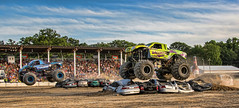 The race is on....... (Kevin Povenz Thanks for the 3,300,000 views) Tags: 2017 july kevinpovenz westmichigan michigan ottawa ottawacounty holland ottawacountyfair monstertrucks truck trucks ford race dirt jump air green blue canon7dmarkii sigma24105art sky stands grandstands spectators fans people cars crush crushed tires outside outdoors bud budweiser trees
