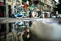 P.S.A. (ewitsoe) Tags: rain puddle summer cool chill city urban bike woman ridingbike cityscape canon eos5ds 50mm street water rainign jezyce legs ewitsoe erikwitsoe reflection reflect mirror glass