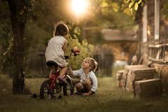 summer at grandma's (iwona_podlasinska) Tags: kids old wooden bike smile happy light flare