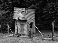 Horrible testimony (RIch-ART In PIXELS) Tags: natzwiller natzweiler struthof blackandwhite monochrome fence watchtower leicadlux6 leica dlux6 lesvosges alsace france barbedwire