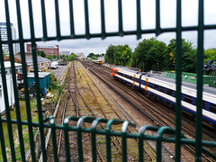 trainspotting (amazingstoker) Tags: train wire hole points cut mesh third peep spotting trainspotting basingstoke railway tracks fence view rail station bridge west eastrop basing hill network south trains norn amazingstoke basingrad