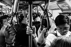 Crowded (torbus) Tags: sukhumvit crowd travelphotography inside southeastasia handheld publictransportation hands 35mm monotone blackwhite skytrain shadows bangkok monochrome closeup street35mmphotography streetphotography street fujifilmx100f asia siam crowded bts thailand