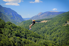 Is It A Bird? Is It A Plane? (Alfred Grupstra) Tags: outdoors sport mountain nature action extremesports sky healthylifestyle exercising jumping blue freedom women females oneyoungwomanonly summer oneperson adventure