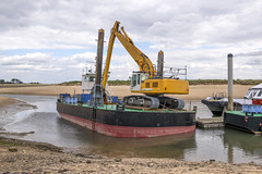 Digger On Board (simonannable) Tags: wellsnextthesea digger maritime earth mover excavator reach barge work machinery nofolk coast coastal low tide adaptability plant longarm boat harbour eastcoast uk england earthmover scoop shovel dredger marroned industry heavyindustry trackedvehicle