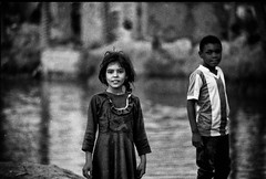 Kids in Southern Iraq. 1991, first Gulf war. After the coalition has bombed the region, water became more expensive than petrol. (rvjak) Tags: irak iraq children kids enfant noir blanc bw black white f3 nikon portrait middleeast