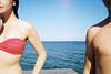 sea between us (Lena Kanshyna) Tags: woman man sea outdoor young summer sunny 35mm dream film filmphoto filmphotography onlyfilm analog analogue girl ukraine odessa kanshyna kodakgold olympus olympusmju2 mju2
