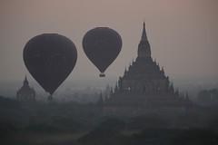 tight squeeze (PawL23) Tags: myanmar hotairballoons shadow silhouette temple bagan balloonsoverbagan dhammayangyi burma asia dawn sunrise misty