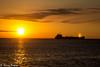 Sur le pont (Thierry Poupon) Tags: cargo lumière mer méditerranée navire orange portlanouvelle reflet soleil bateau ciel contrejour lever leverdesoleil nuages languedoc france fr
