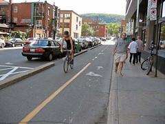 Montreal Cycle Track (SAFEbuiltstudio) Tags: urban city bike bikelane parking street pedestrian multistory