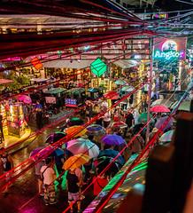 Blade Runner feeling in Siem Reap (holzer_r) Tags: sieam reap cambodia bladerunner blade runner asia kambodscha ridley scott pubstreet pub street old french quarter nightlife rain umbrella regenschirm regen nacht nachtfotografie