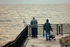 Morning fishing on Lake Michigan (Cragin Spring) Tags: wisconsin wi midwest unitedstates usa unitedstatesofamerica portwashington portwashingtonwi portwashingtonwisconsin lakemichigan fishing people water pier morning fence