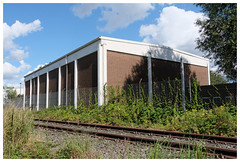 Storehouse (awbaganz) Tags: house hamburg germany europe fence tracks railway grass overgrown sky clouds fuji xpro2 xf18135 summer trees