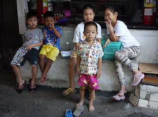 children in front of a convenience store