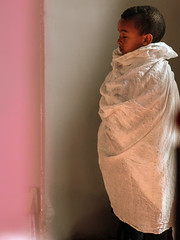 How to raise the next dalai lama? (ybiberman) Tags: israel jerusalem ethiopianchurch ethiopiancathedral boy pray veil portrait candid streetphotography white pink