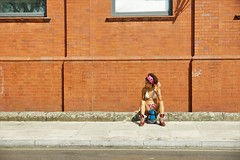 Waiting in London for the Carnival (gooey_lewy) Tags: hill carnival notting celebration party costume colour bikini waiting london beautiful girl lady women mixed race frizzy hair