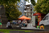 Green and Orange Stools (Jocey K) Tags: newzealand nikond750 southisland christchurch architecture sky clouds buildings cbd city people trees cathedralsquare foodvan stools sculpture demolition