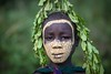 Suri Tribe, People of the Omo Valley, Ethiopia - Tribu Suri, Peuple de la Vallée de l'Omo, Éthiopie ( Jean-Yves JUGUET ) Tags: tribe tribal tribu tribes ethnic ethnology ethnie culture tradition ethiopia ethiopie tulgit turgit kibish surma suris suri field boy kid child tree arbre peuledelavalléedelomo peopleoftheomovalley nomadicpeople artistic pigments rite bodypainting adornment east africa