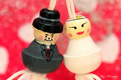 Two hearts connected... (Maria Godfrida) Tags: macromondays connection macro closeup love marriage dolls pair couple two duo goodluchcharms husbandandwife brideandgroom mascot hearts bokeh 7dwf