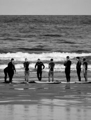 Learning to surf (LRHS2010) Tags: surfers lesson men newquay fistral monochrome reflections teacher students cornwall