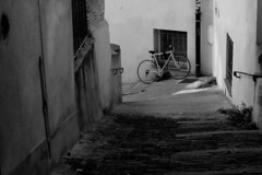 Bicycle only bicycles (Simona e Graziano) Tags: blackandwhite bn bnw bw streetphoto street photography photos flickr blackwhite black white monocrome mono grey noireblanc noir blanc blanco blancoynegro negro negroyblanco bicycle alone darkness town city old oldtown steps down