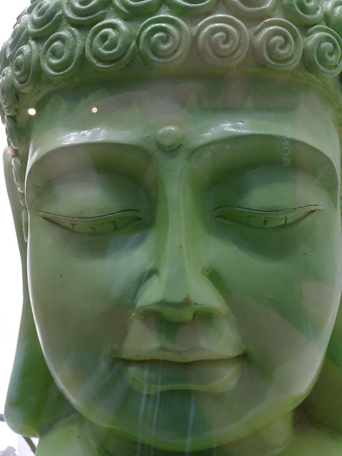 Buddha image in the store window of an optician shop in Wittenberg (Germany)