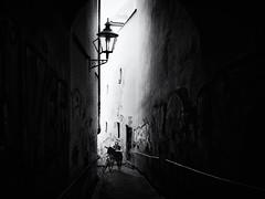 Narrow alley (Sandy...J) Tags: atmosphere alone blackwhite bw black city darkness grafitti photography white monochrom street streetphotography walking alley light mood bicycle women urban noir olympus oldtown