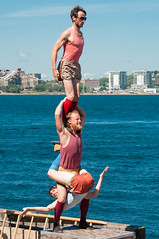 Throw2Catch - #MadeInKougistan (Grant is a Grant) Tags: 55300 buskers buskersfestival buskershfx hfx halifax halifaxbuskerfestival halifaxbuskers halifaxwaterfront nikkor55300mm nikond90 throw2catch acrobat acrobats downtownhalifax jugglers summer novascotia canada ca