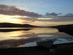 Sunset on Kirbister loch (stuartcroy) Tags: orkney island kirkwall kirbister loch reflection beautiful blue bay boat black water weather scotland sea sky scenery sony still sand sunset
