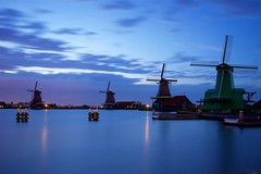 Zaanse Schans millscape (l.cutolo) Tags: tlp water ngc zaandam silkycould on1raw hdr landscape netherlands longexposure millscape zaanseschans dutchlandscape worldtrekker bluehours windmills blue aperture village silkywater dusk lights oldtowns sonyfe2470mmf40zaoss