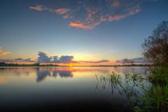Sunset over Lake Manatee (ap0013) Tags: sunset lake manatee florida lakemanatee floridasunset water reflection beautiful hdr sun sky clouds