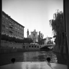Ljubljanica River Boat Ride (Blurmageddon) Tags: mediumformat film analogphotography 6x6 holga120gcfn tmy400 tmax400 kodak rodinal semistand standdeveloped blackandwhite europe travel vacation epsonv700 toycamera plasticfantastic ljubljana