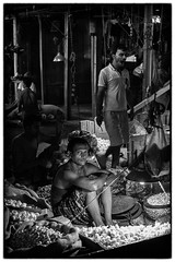 The merchant (Chaschaser) Tags: asia india kolkata market travel mono blackwhite