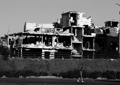 The human capacity for survival - Hidden strength shines in times of tragedy and war. (DanaKhoudari) Tags: architecture people boy life black white building canon national nation war peace street arab