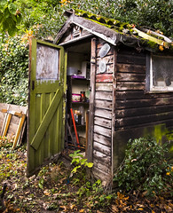 The Old Tool Shed (simonannable) Tags: fujifilmxt1 fujixt1 fujifilm shed garden old aged image wooden untidy shabby chic gardens detail worn opendoor sheddoor mancave explore 1000views 2000views 3000views inexplore shack toolshack toolshed 4000views 5000views qualitystreets qualitystreet tin oldtins sweettins