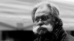 Max (Neil. Moralee) Tags: neilmoralee neilmoraleenikond7200 mustache max maximum arge huge hair facial man old mature male glasses blacj white bw blackwhite blackandwhite mono monochrome neil moralee nikon d7200 face portrait candid street german germany proud distinguished grand grande large cold winter people