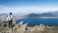 Lake Hawea (newzild) Tags: newzealand teararoa hiker tramper trail route long distance capereinga bluff nzl south island lake hawea mountain hill rocks backpack trekking poles woman landscape vista panorama panasonic gm5 1232 24mm equivalent wide angle ultrawide