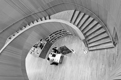 Making Enquiries (Douguerreotype) Tags: monochrome spiral buildings docklands city bw wood uk library british england mono blackandwhite stairs architecture britain gb london urban helix people steps