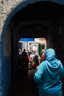 Veiled woman in djellaba walking in medina, Tétouan, Morocco
