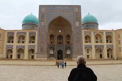 Looking at the impressive facade of Mir-i-Arab Madrasa in Bukhara, Uzbekistan