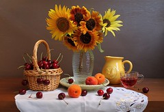 Look  at  Sunflowers (Esther Spektor - Thanks for 12+millions views..) Tags: stilllife naturemorte bodegon naturezamorta stilleben naturamorta composition creativephotography arrangement artisticphoto summer tabletop bouquet flowers sunflower food fruit apricot cherry juice vase basket pitcher cup plate doily embroidery glass cramics availablelight reflection white yellow orange red green brown burgundy estherspektor canon