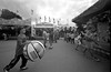 Boy with Large Ball. Midway. Minnesota State Fair. September, 2017 -      Leica M6, 25mm, TM100.     L_M6_21592 (erlin1) Tags: 2017 analog blackandwhite leicam6 minnesotastatefair september stpaul statefair summer tm100 tmaxdeveloper mn usa