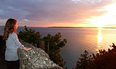 BRILLIANT............ (marsha*morningstar) Tags: child girl female sunset lake michigan rock stone treetops mackinaw bridge water waterfront rays island