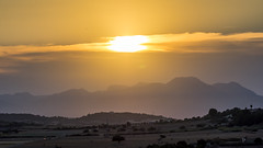 Setting over the mountains (Jens Haggren) Tags: sun sunset light clouds mountains silhouettes landscape view rural car aeroplane houses road trees mallorca majorca spain