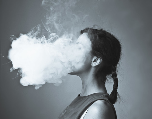 Woman smoking electronic cigarette creating cloud of vapor E-Cigarette | Electronic Cigarette | E-Cigs | E-Liquid | Vaping | Cloud Chasing (monochrome), From FlickrPhotos